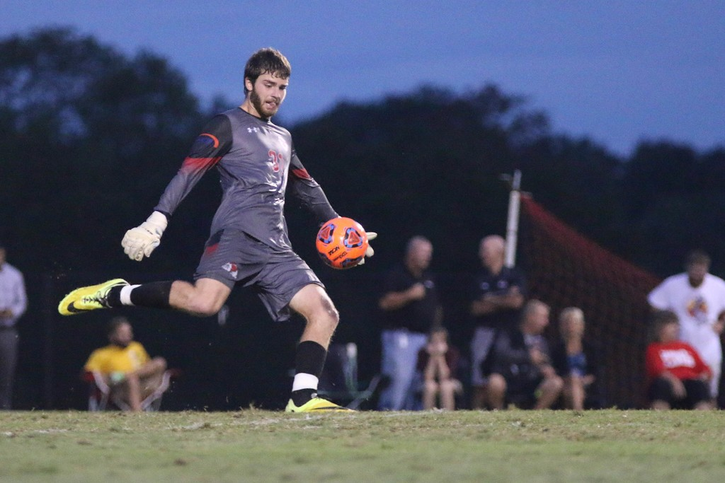 Sophomore goalie William Liles, 31, kicks the ball in.