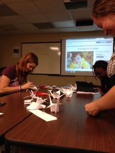 The Japanese Club folds paper cranes. Courtesy of Dr. Pagcaliwagan.