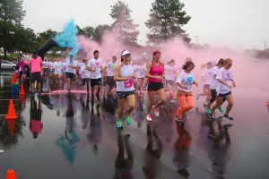 Despite the wet weather, runners greeted Saturday morning with a splash of color at the Color Dash. Photo by Megan Hartman.