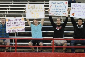 Fans in the stands supporting their favorite players. Photo by Elizabeth Banfield.
