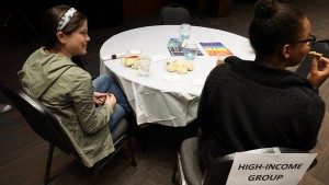 Those Students placed in the high-income class got to sit at a table and eat a full meal served by someone else. Photo by: Elizabeth Banfield.