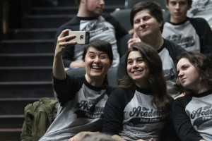 High school students take selfies while waiting on the next performance in Dover Theatre. Photo by Megan Hartman.