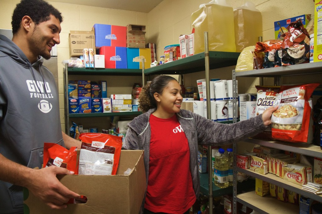 Nearby, another group of students organize the pantry at the Cleveland County Rescue Mission.