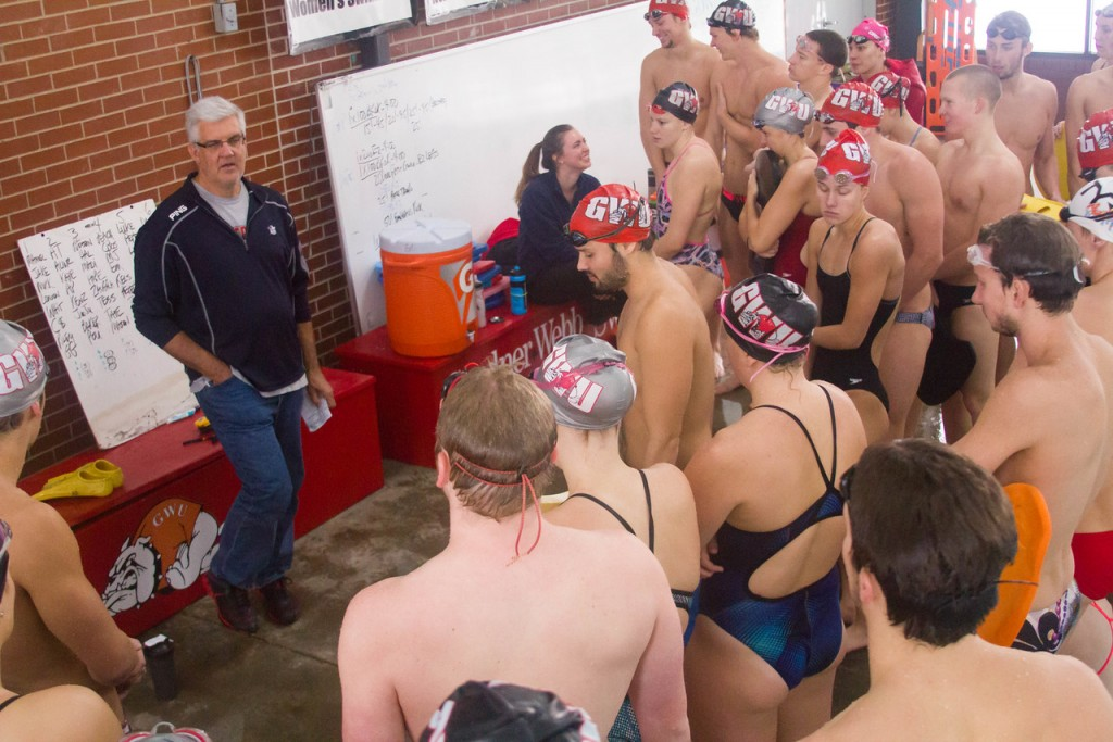 Coach Mike Simpson explaining the relays to the team.