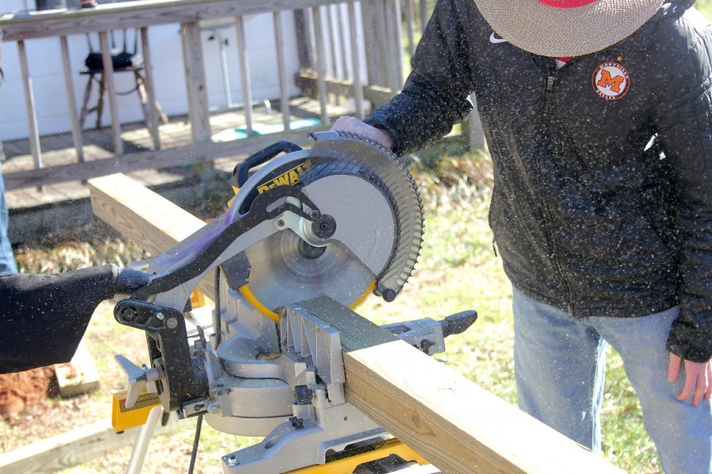 A circular saw is used to cut a support beam.