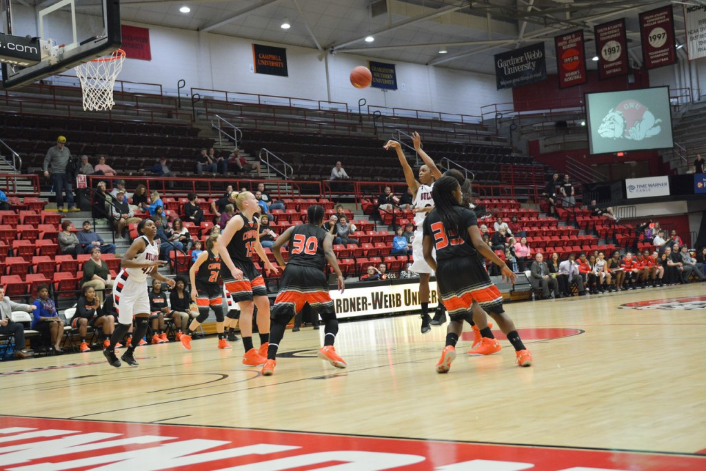 22, Candace Brown shoots the ball for a two-pointer. Brown led the team in scores, producing 17 points throughout the game.