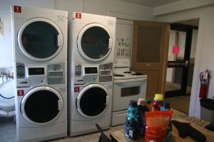 Residents of HAPY share four laundry machines. Photo by Megan Hartman