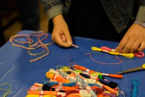 After the disability panel, students had the opportunity to make friendship bracelets of many different colors. Photo by Madison Weavil