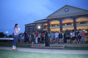 Seniors gathered to hear Caitlyn Brotherton, the senior class president, say a few words before they released their lanterns. Photo by Elizabeth Banfield